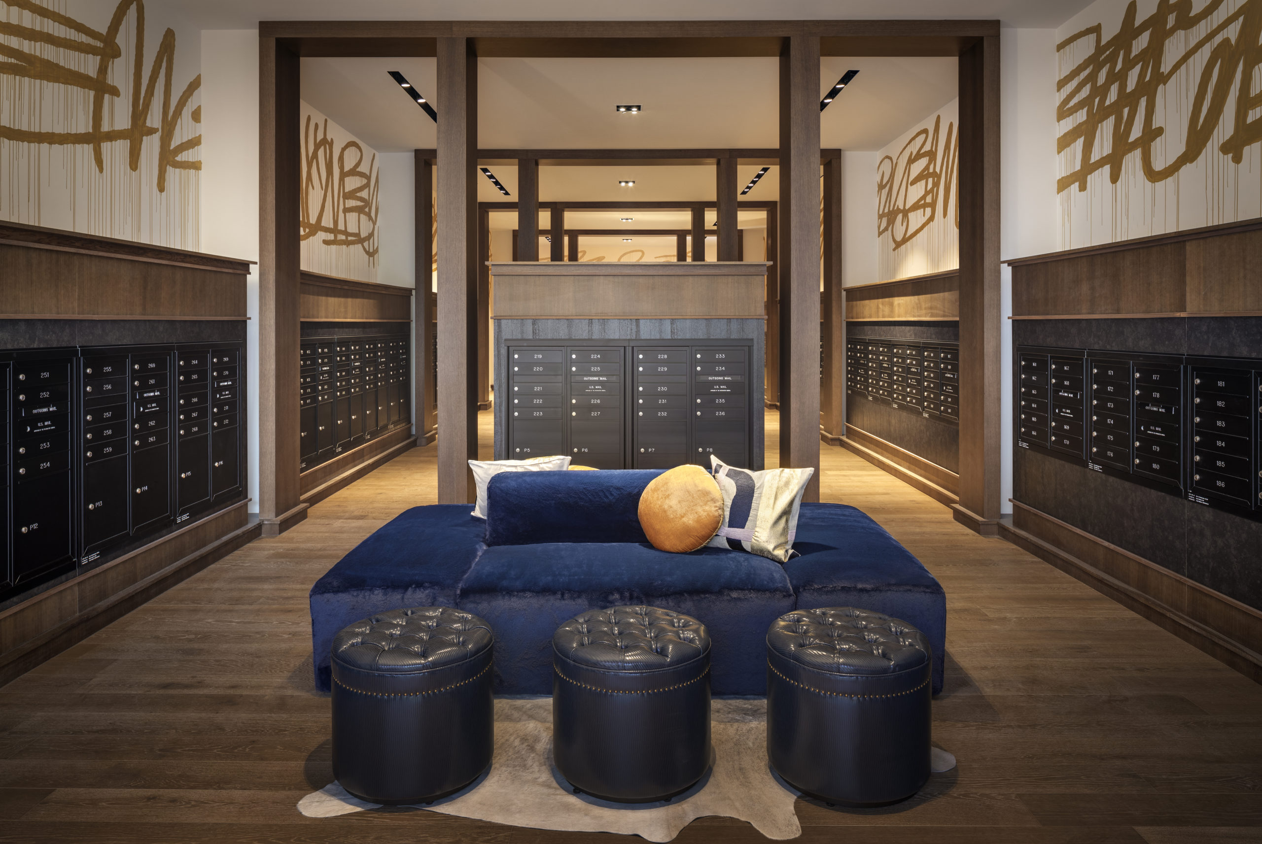 resident mailroom with blue couches and ottoman