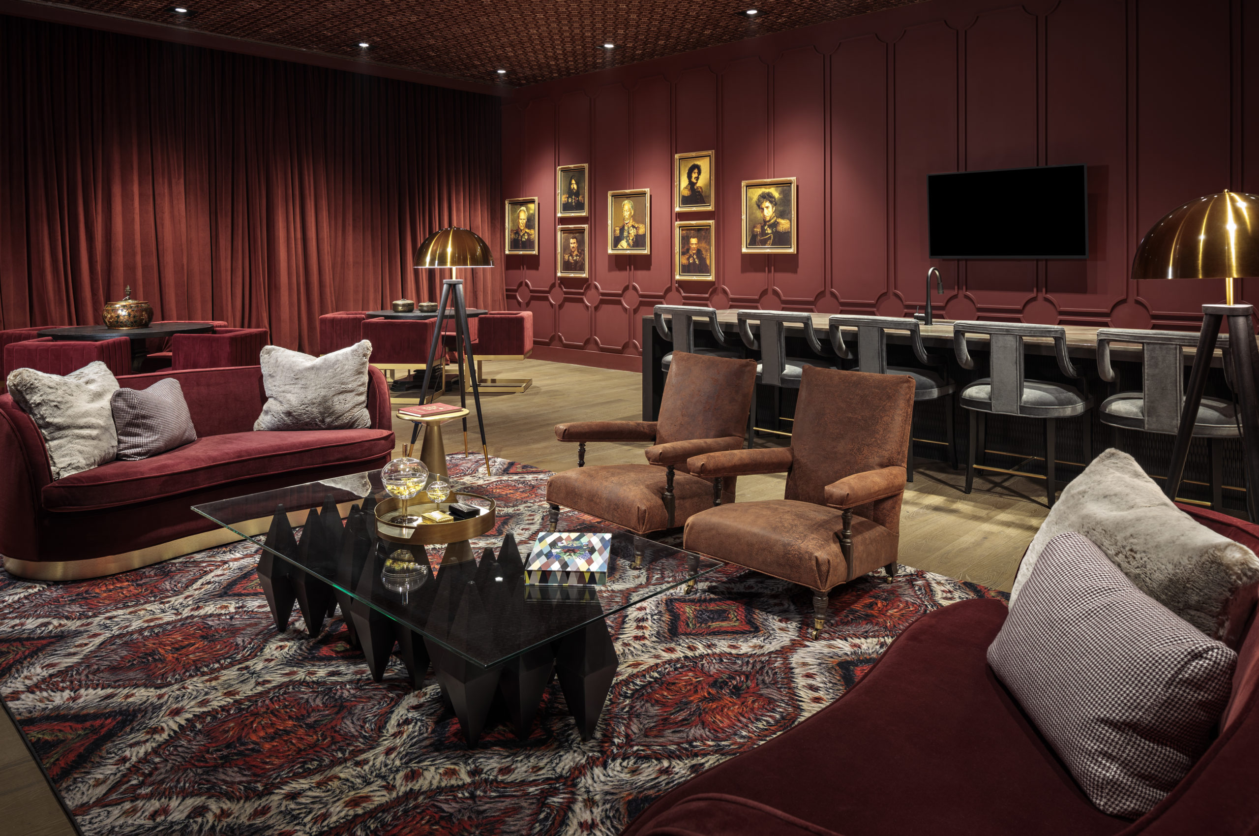 resident clubroom with red velvet seats and red walls