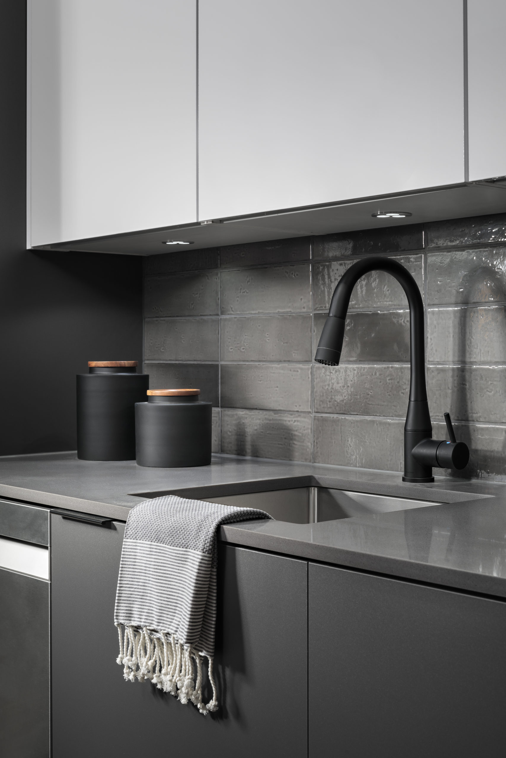 black kitchen faucet and gray countertops