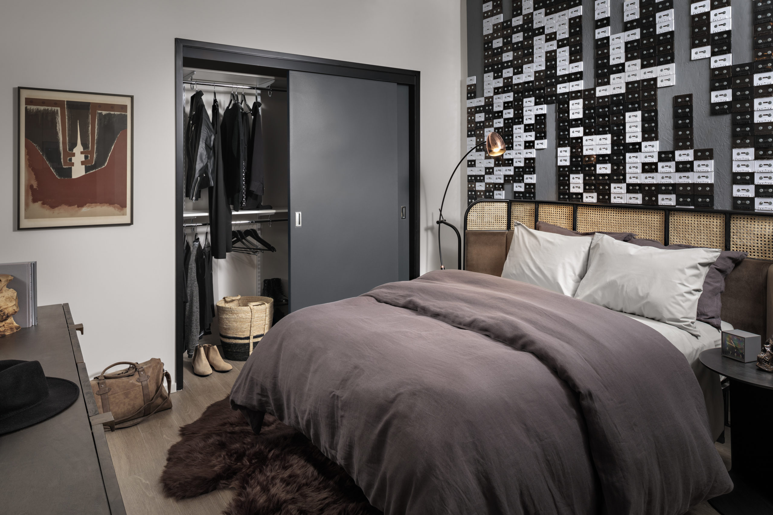 full size bed with black duvet in spacious bedroom