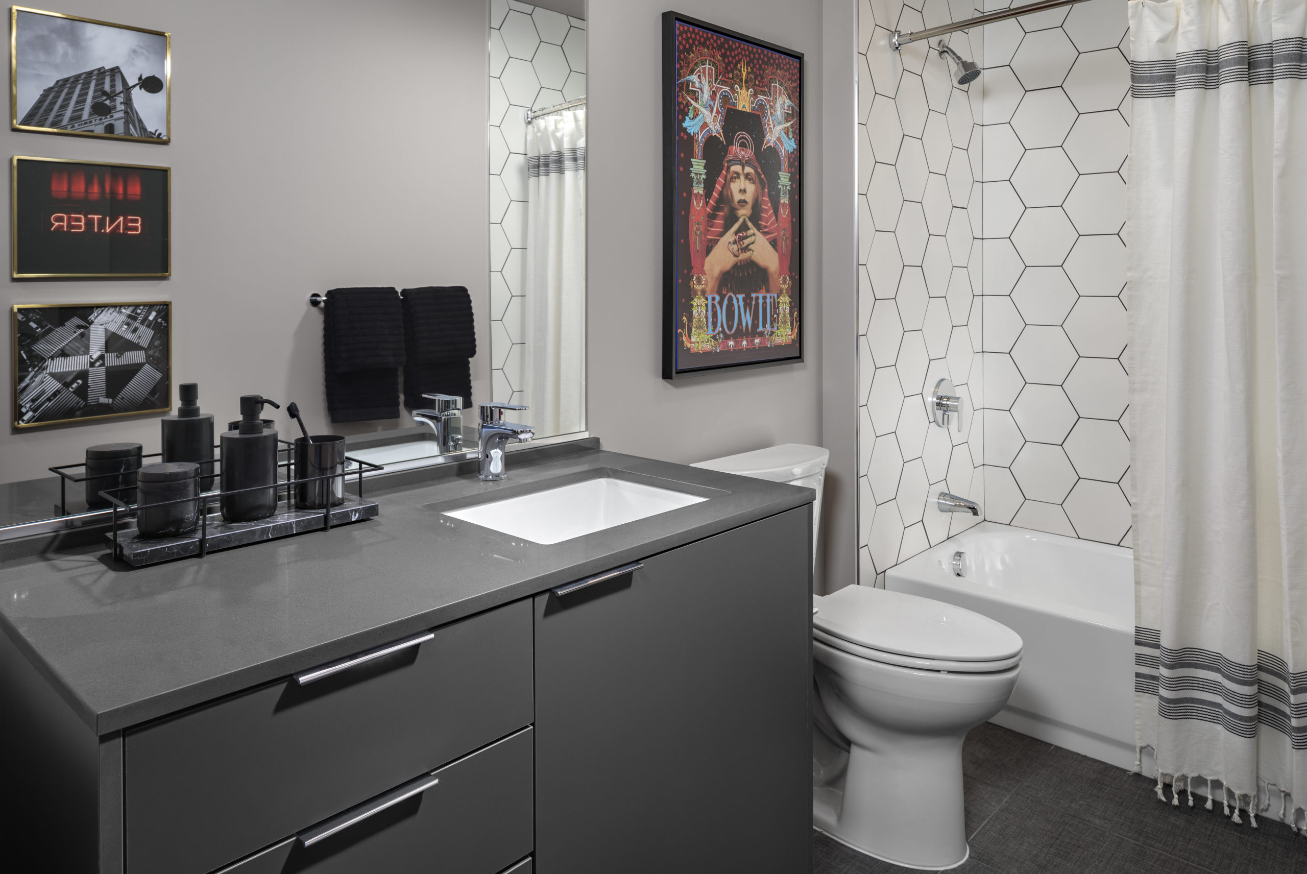 modern gray bathroom with white shower and tub